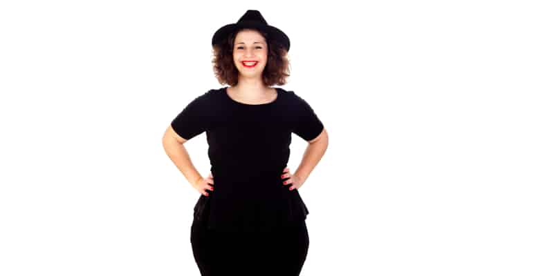 pear-shaped woman in a black hat