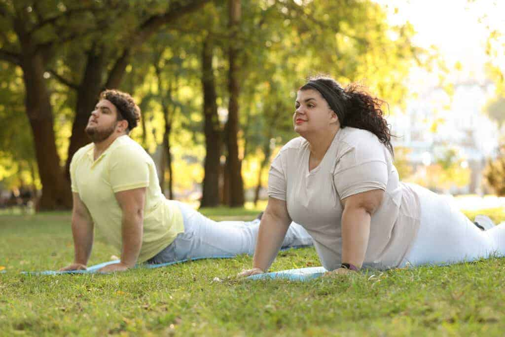 couple working out in a plus size relationship