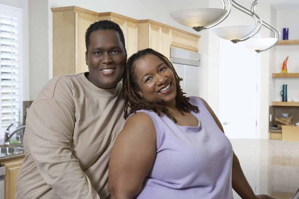 plus size couple in their home