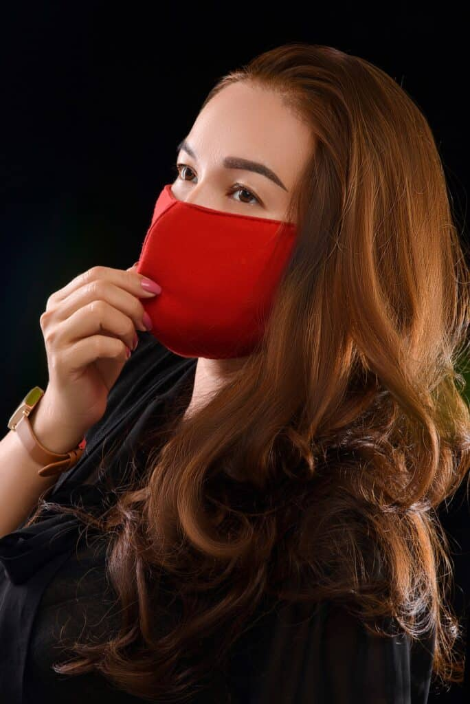 woman wearing a red face mask