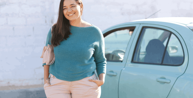plus size woman standing next to her car