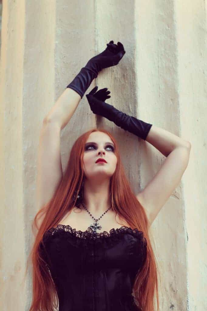 woman posing in plus size Goth clothing