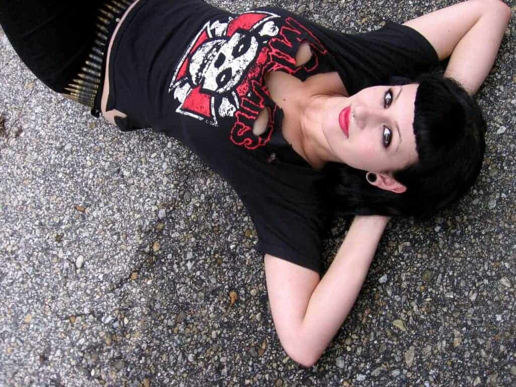 woman relaxing in Goth clothing